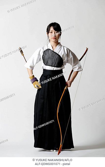 Japanese traditional archery athlete against white background