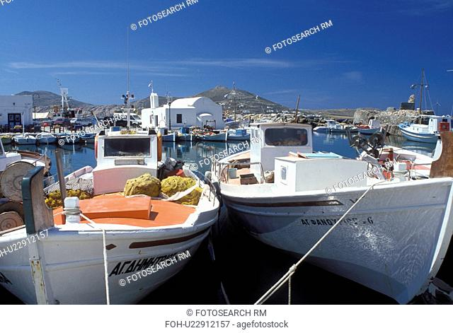 Paros, Naoussa, Greek Islands, Cyclades, Greece, Europe, Fishing boats docked on the waterfront on Naoussa Harbor on Paros Island on the Aegean Sea