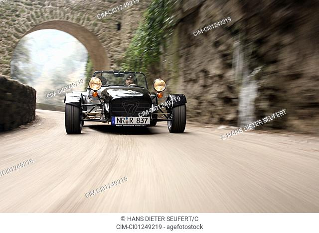 Caterham CSR 200, model year 2006-, silver, driving, diagonal from the front, frontal view, country road, landsapprox.e, Mountains, open top