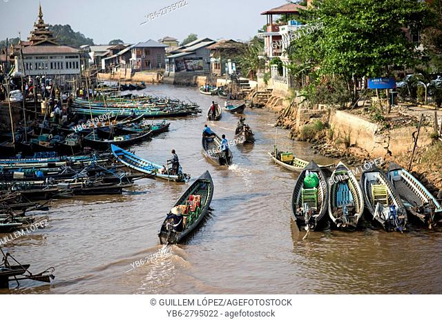 Traditional boats on canal heading to the Inle Lake, Nyaungshwe, Myanmar
