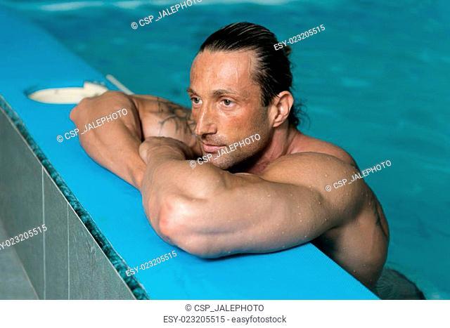 Mature Looking Macho Man At Hotel Indoor Pool