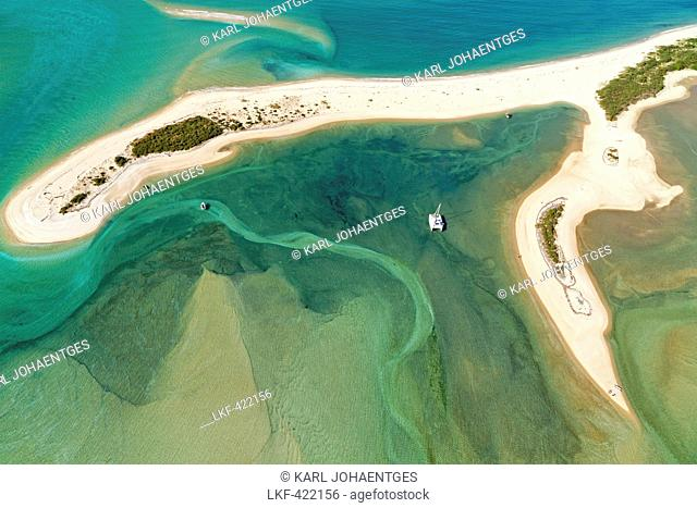 blocked for illustrated books in Germany, Austria, Switzerland: Aerial view of the Awaroa Inlet with catamaran, blue-green marine water