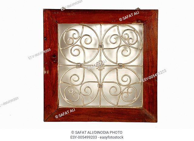 Flower design on wooden iron hanging frame ; Jodhpur ; Rajasthan ; India