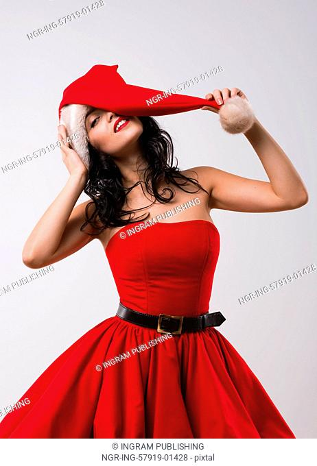 Beautiful sexy girl wearing Santa Claus clothes alluring