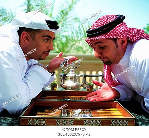 Arab men playing backgammon