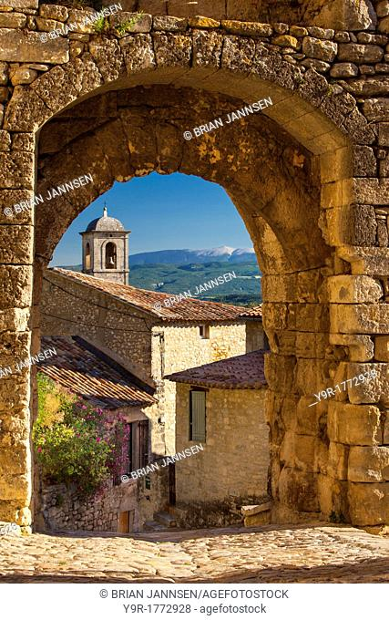 Stone gate in Lacoste with Mount Ventoux beyond, Provence France