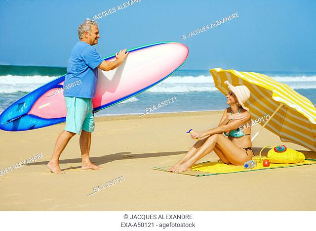 Active senior couple enjoying their holiday on a beach