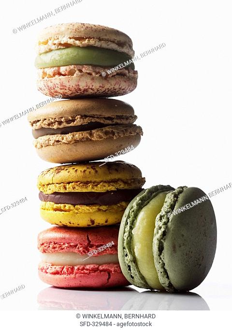Different coloured macarons, stacked small French cakes