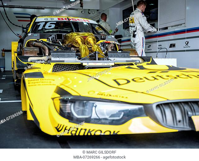 DTM racing car in pit, opened bonnet
