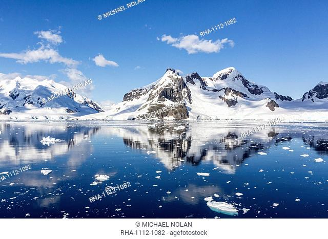 Snow-capped mountains in the Errera Channel on the western side of the Antarctic Peninsula, Antarctica, Southern Ocean, Polar Regions