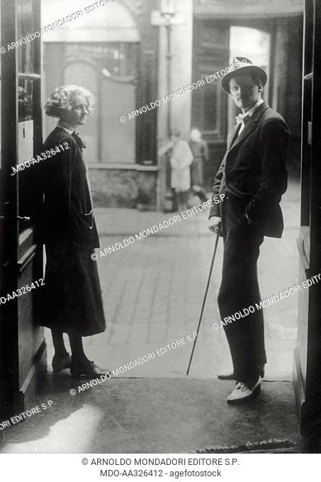 James Joyce with Sylvia Beach. The Irish writer James Joyce posing on Shakespeare and Company bookshop doorstep along with the owner of the bookshop