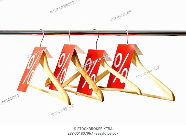 Row of hangers with red labels showing holiday discount