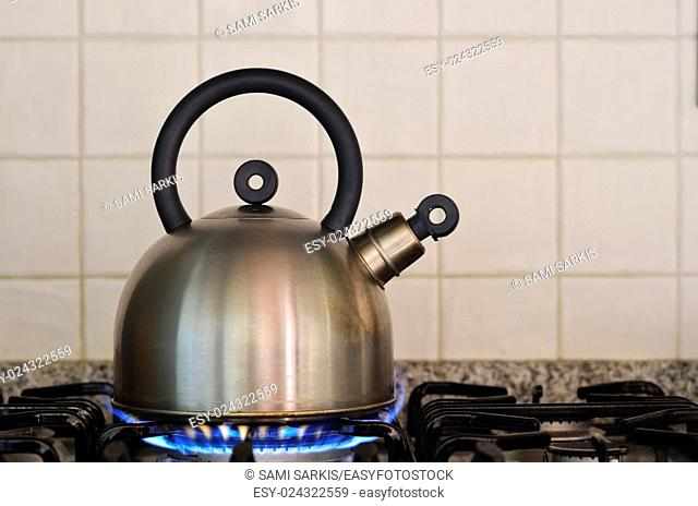 Teapot on gas stove burner