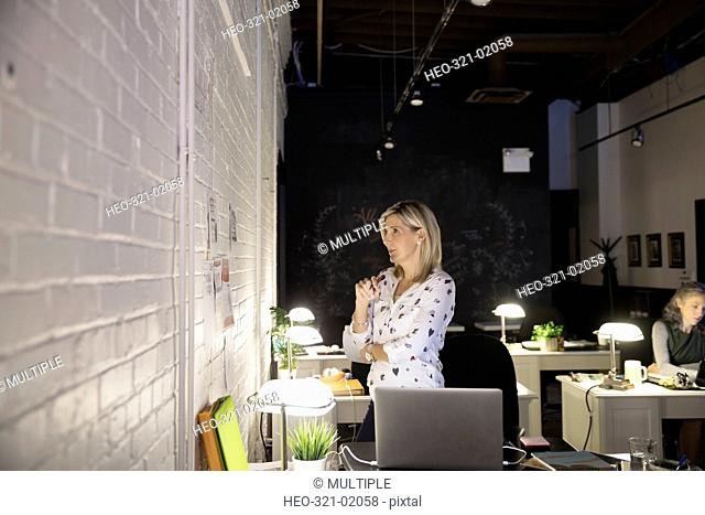 Focused creative businesswoman working late brainstorming in office