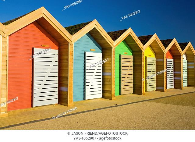 England, Northumberland, Blyth  New colourful beach huts on the promenade at Blyth Beach