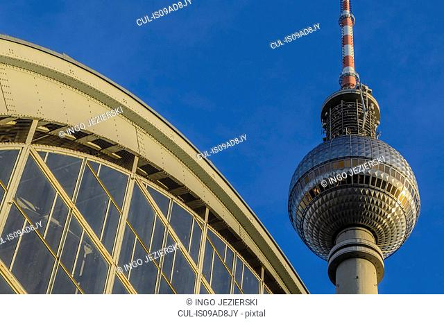 Arch of Alexanderplatz station with TV Tower, Berlin, Germany