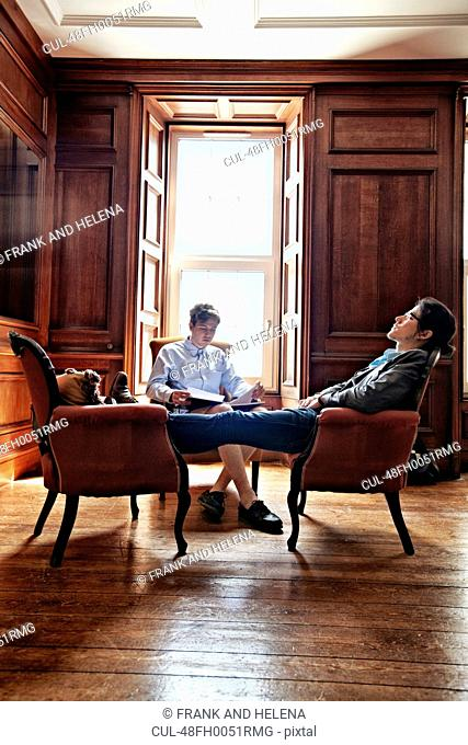 Men napping in armchairs