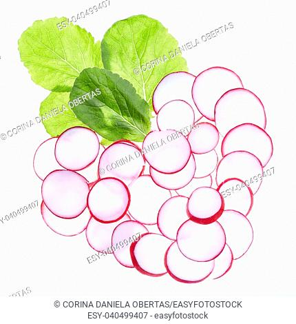 Slices of radish in a heart shape, illuminated from the back, over white background