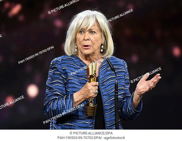 """03 May 2019, Berlin: The director and actress Margarethe von Trotta thanks the 69th German Film Award """"""""Lola"""""""" during the award ceremony for the honorary prize..."""