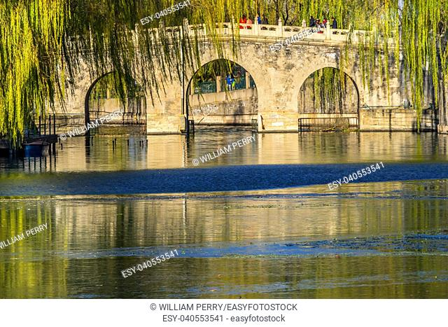 Bridge Green Willows Jade Flower Island Beijing China Beihai public park created 1000AD.