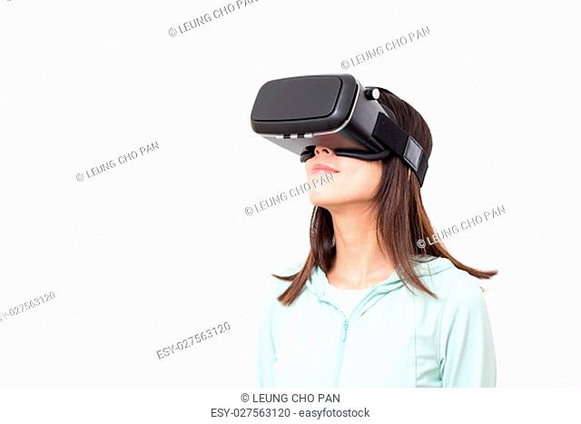 Young woman looking though virtual reality