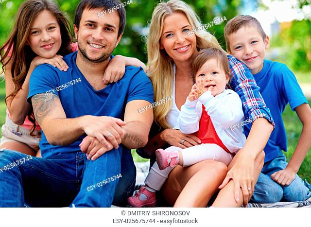 Portrait of happy family with three children