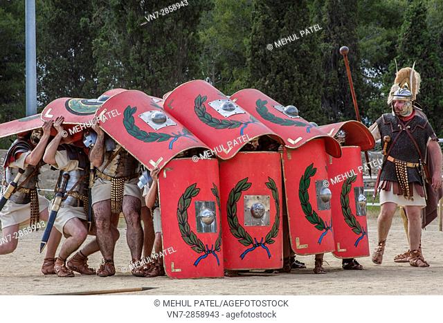 Live reenactment of Roman Legionnaires in defensive combat position during 'Tarraco Viva' festival, Tarragona, Catalonia, Spain