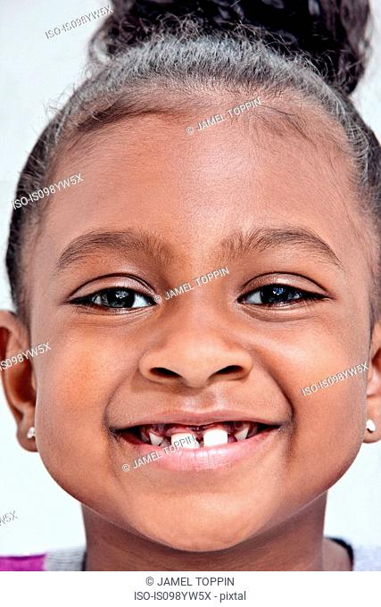 Girl smiling with gap tooth