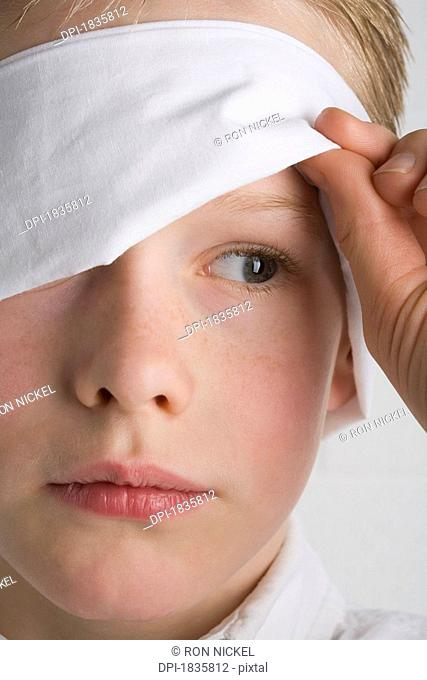 Boy with a blindfold on