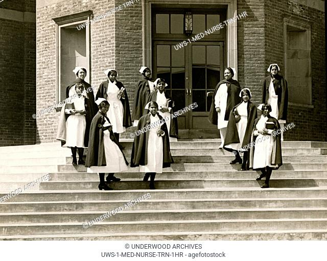 New York, New York: c. 1929 African American nurses on the steps of the Lincoln Training School for Nurses at 141st Street and Southern Boulevard in the Bronx