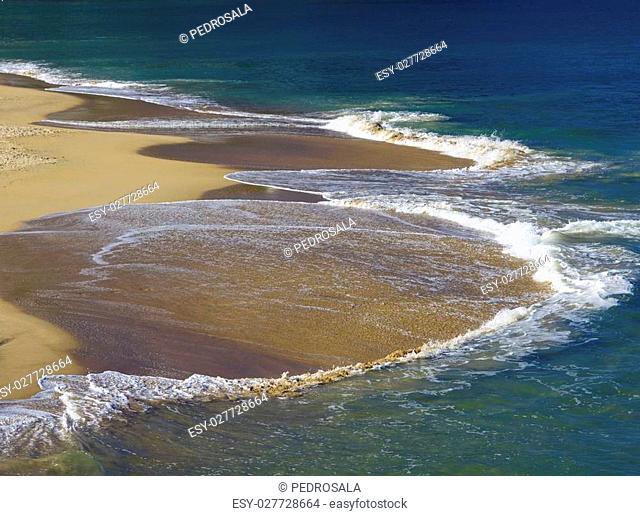 Waves on sandy beach, San Sebastian, Spain