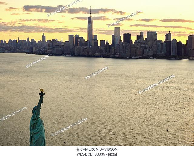 USA, New York City, Aerial photograph of the Statue of Liberty at sunrise