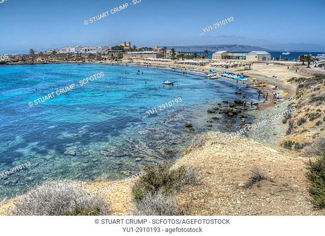 HDR image of tourists boats and pedalos on the beach on the island of Tabarca
