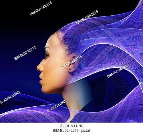 Flowing light waves from profile of Mixed Race woman