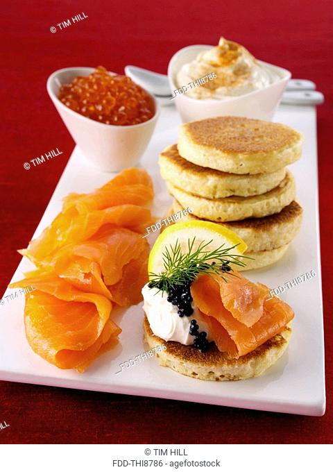 Blini with smoked salmon salmon roe and cream cheese
