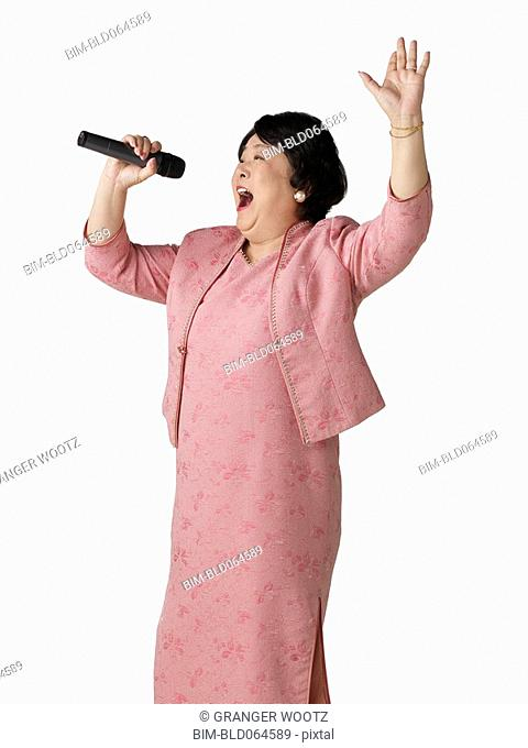 Confident Asian woman singing