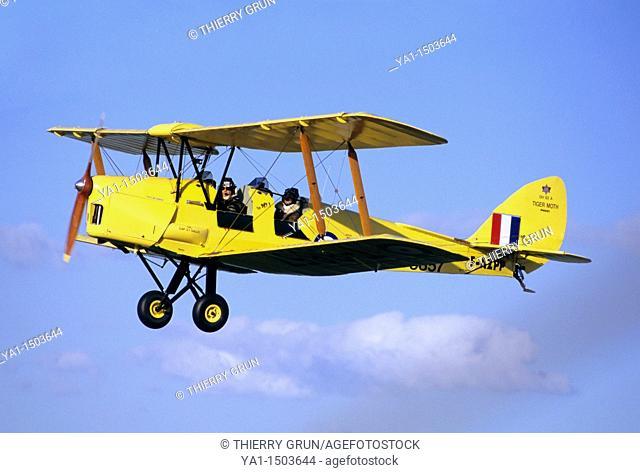 Old British trainer biplane De Havilland DH-82a Tiger Moth in flight over France