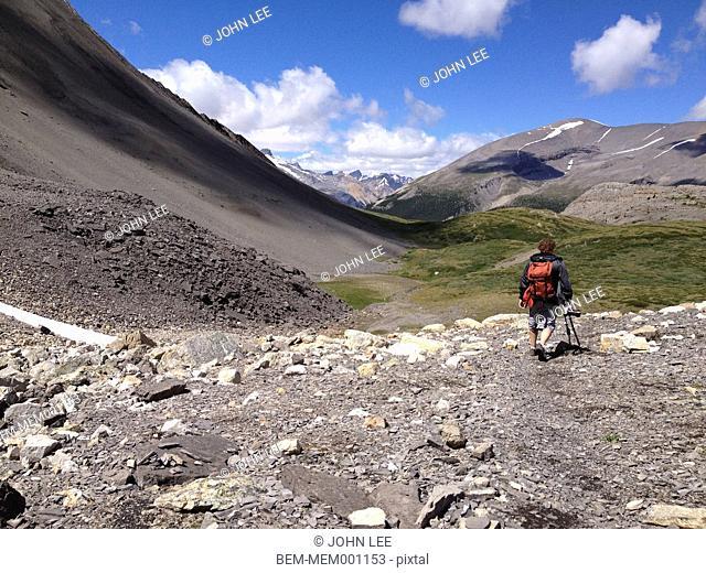 Caucasian hiker in Columbia Icefields, Wilcox Pass, Jasper, Alberta, Canada