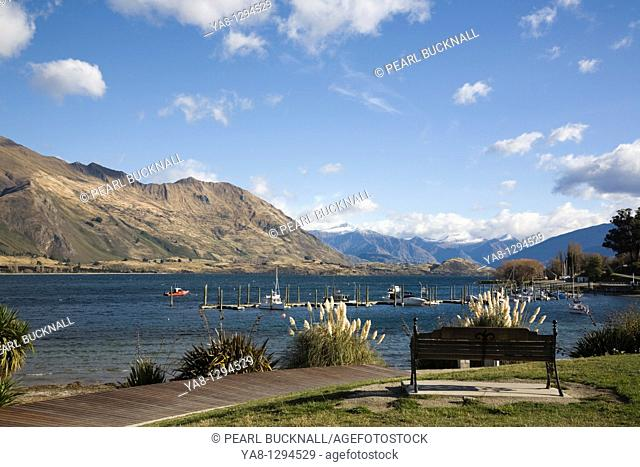 Wanaka, Otago, South Island, New Zealand  View across marina at southern end of Lake Wanaka to western shore from lakeside walk in Roys Bay recreational reserve