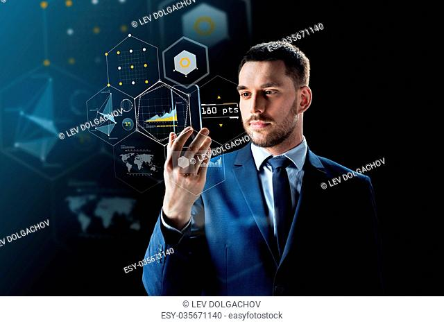 business, augmented reality and future technology concept - businessman working with transparent smartphone and virtual screens projections over black...