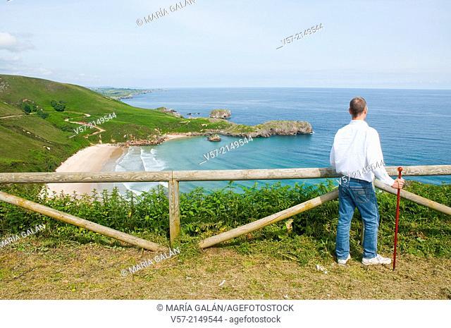 Man at the viewpoint over Torimbia beach. Niembro, Asturias, Spain