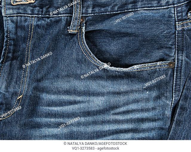 empty front pocket of blue jeans, full frame