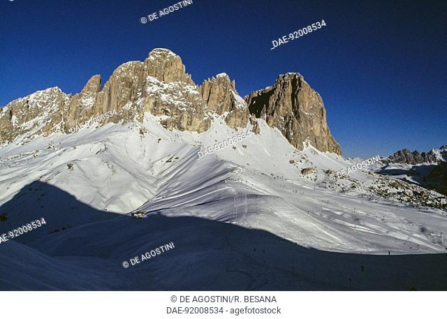 Shadow of Col Rodella on the snow-covered foothills of the Dolomites of the Langkofel-Sassolungo Group, Fassa Valley, Trentino-Alto Adige, Italy