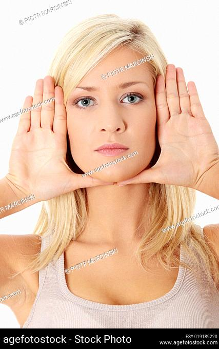 Beautiful woman making frame on her face