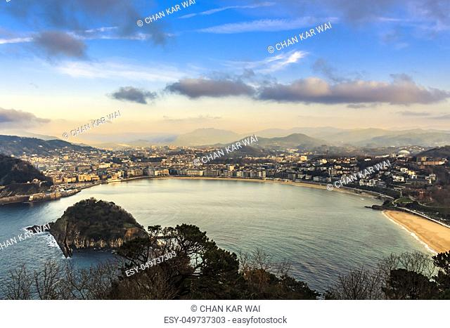 Aerial view of the resort town of San Sebastian in the mountainous Basque Country, Spain taken in the evening