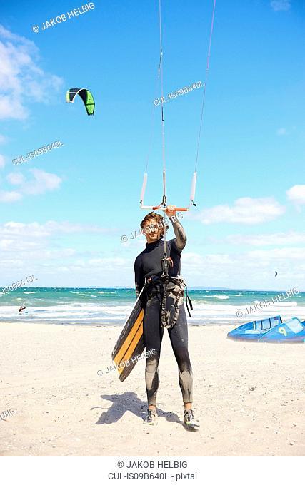 Kite surfer holding onto control bar, Hornbµk, Hovedstaden, Denmark