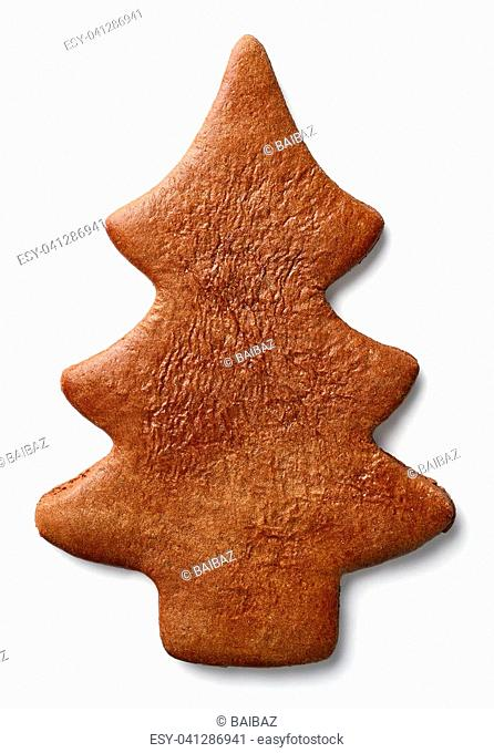 Christmas tree shaped gingerbread cookie isolated on white background. From top view