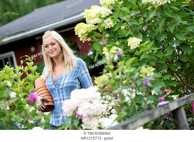 An organic flower plant nursery. A woman working