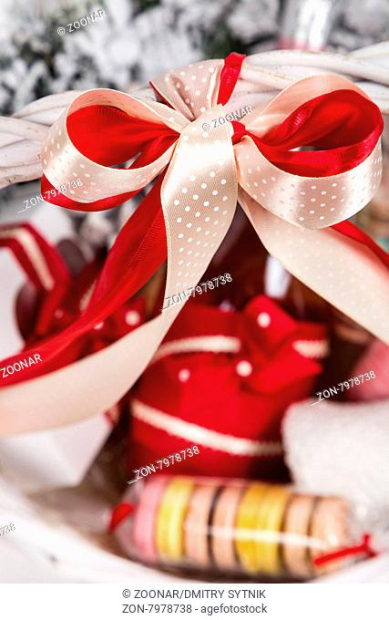 sweet christmas present in basket with pastry macaroons and decor