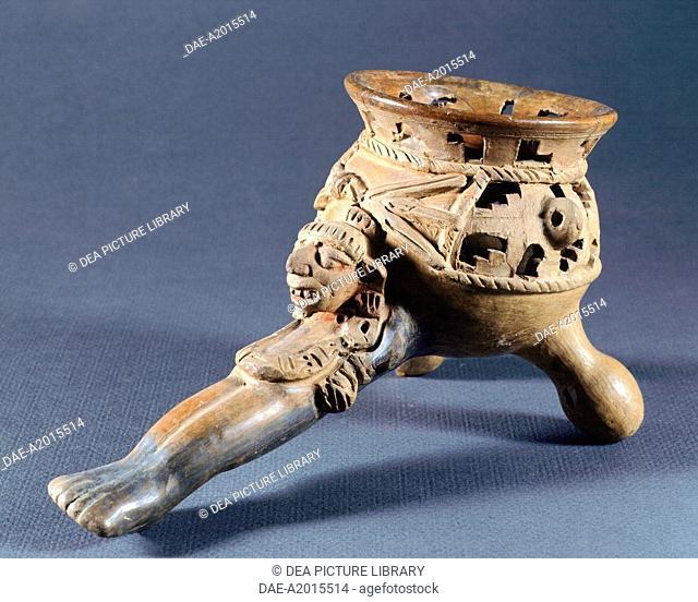 Terracotta incense burner showing a female head from Yagul, Mexico. Mixtec Civilization, post-classical period 900-1521.  Oaxaca